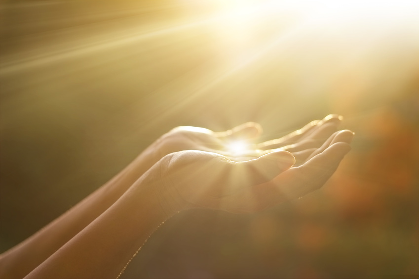 Respect and pray, human hands on nature background
